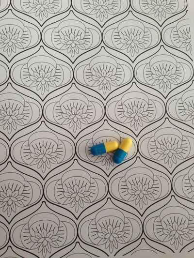 Pills. Me Myself I (and My Endometriosis) Everyday Life Capsules And Pills Capsule Yellow Blue Yellow From My Point Of View Real Life Real Life Situation Real Life Photography Endopute Endogirl Endofighter Endometriose Mes C****** Fightlikeagirl Endometriose Endometriosis Pain Pain Killer Pills No People Art And Craft Pattern Indoors  High Angle View Directly Above Still Life Blue