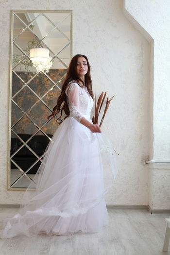 One Person Full Length Women Fashion Adult Real People Young Adult White Color Wedding Standing Celebration Indoors  Looking At Camera Bride Beautiful Woman Clothing Wedding Dress Young Women Dress Hair Hairstyle