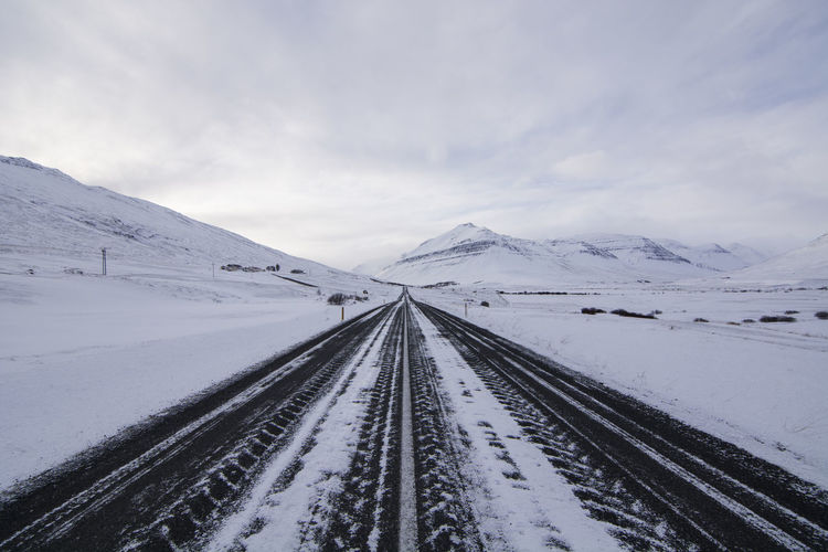 Tire tracks on road during winter