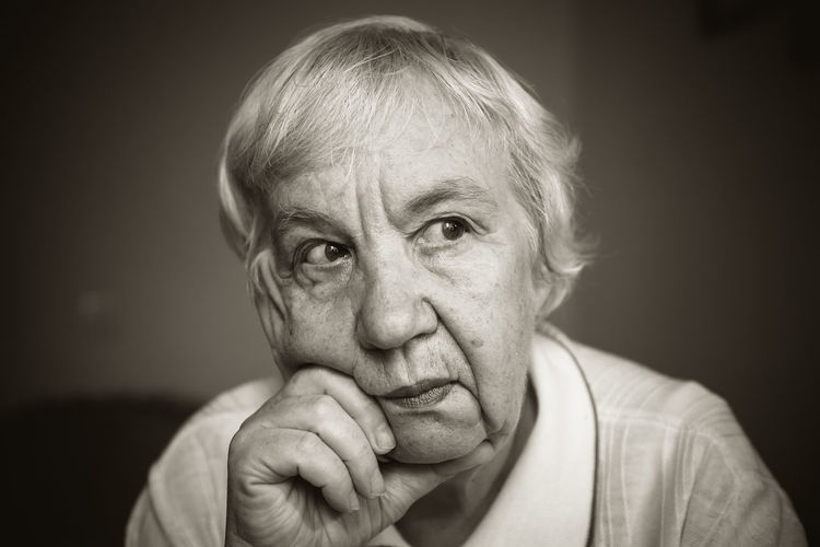 Adult Adults Only Black Background Close-up Depression - Sadness Headshot Human Body Part Human Hand Indoors  Looking At Camera One Person People Portrait Real People Senior Adult Wrinkled
