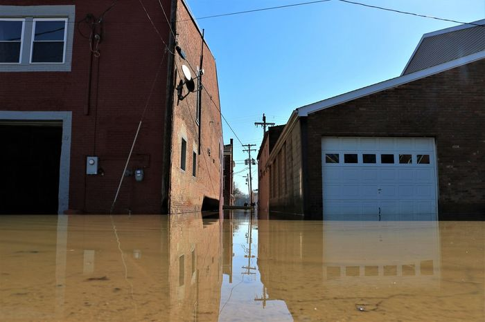 February 2018 flood of Aurora, Indiana. (Flood receding) 2018 Event Low Angle View Ohio River Architecture Boat Building Exterior Clear Sky Day Flood Garage House Low Angle Of View No People Outdoors Reflection Reflections In Water Residential Building River River Flood Sky Water