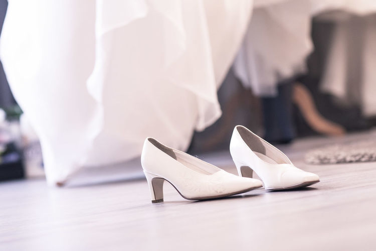 Close-up of white shoes on floor