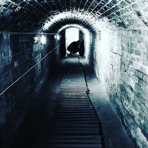 Narrow passage in tunnel