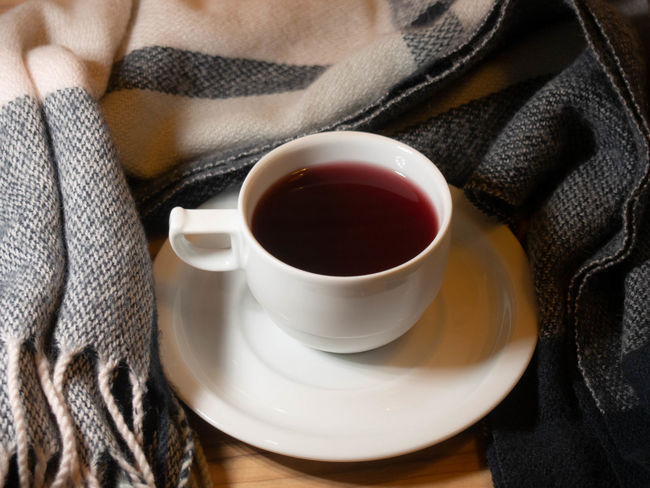 Drink Mug Cup Food And Drink Coffee Cup Refreshment Coffee Coffee - Drink Close-up Hot Drink Saucer One Person Indoors  Crockery Tea Midsection Relaxation Tea - Hot Drink Sweater Adult Tea Cup Warm Clothing Drinking Scarf Black Tea