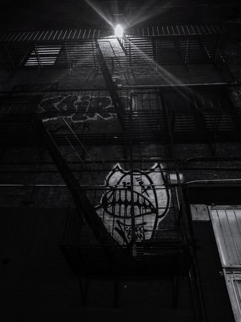 Graffiti Beast Lurking Nyphotography Graffitiphotography Concrete Jungle Graffiti Black And White NYC Photography NYC Urbanphotography Nygraffiti Fireescape Light And Shadow Light In The Darkness Lurking Urban Art No People Night City