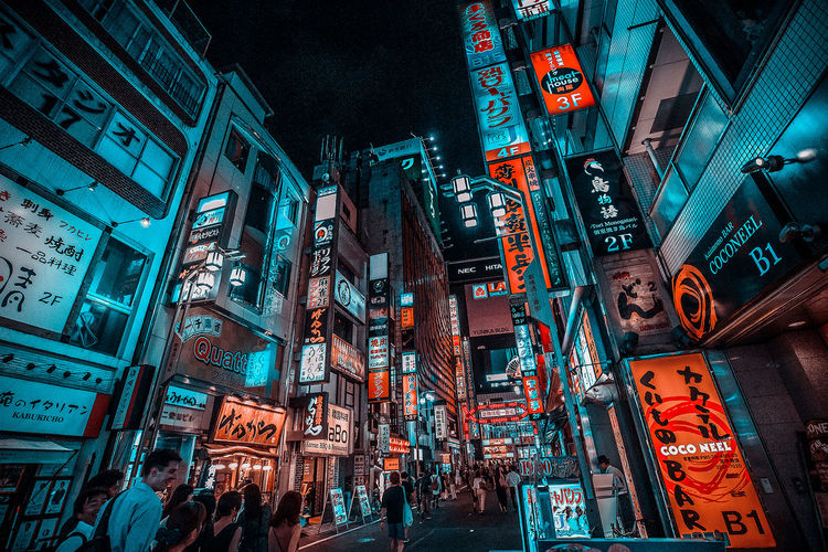 Advertisement Architecture Building Building Exterior Built Structure City City Life City Street Commercial Sign Communication Crowd Group Of People Illuminated Low Angle View Neon Night Nightlife Outdoors Road Sign Street