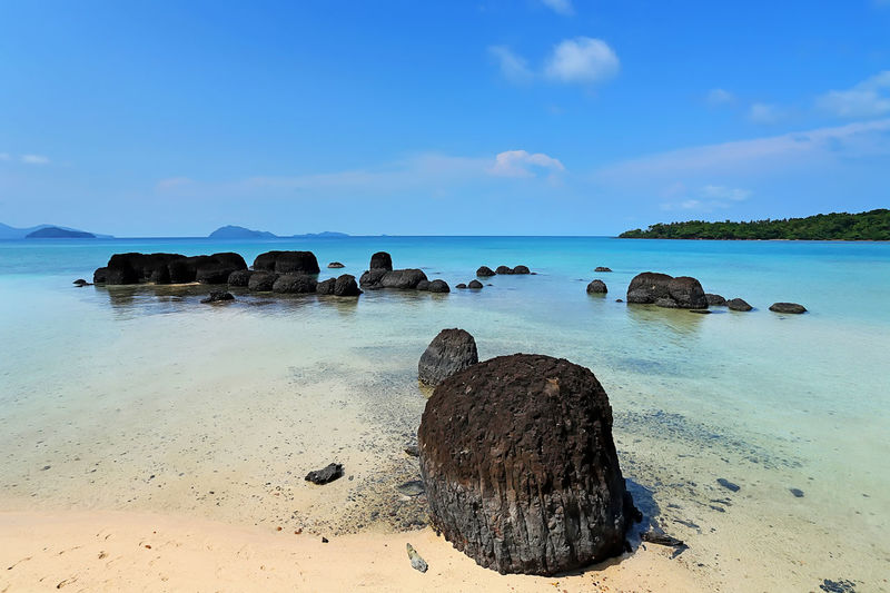 Strange rocks and clear sky on the Koh Kham Beach at Trat, Thailand Water Sea Sky Rock Land Scenics - Nature Beauty In Nature Beach Tranquil Scene Solid Tranquility Nature Rock - Object Horizon Over Water Horizon No People Cloud - Sky Blue Day Outdoors Stack Rock Thailand ASIA