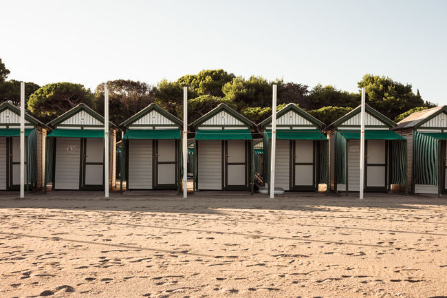 Architecture Beach Beach Hut Building Building Exterior Built Structure Clear Sky Copy Space Day Hut In A Row Land Nature No People Outdoors Plant Row House Sand Side By Side Sky Tree Venice
