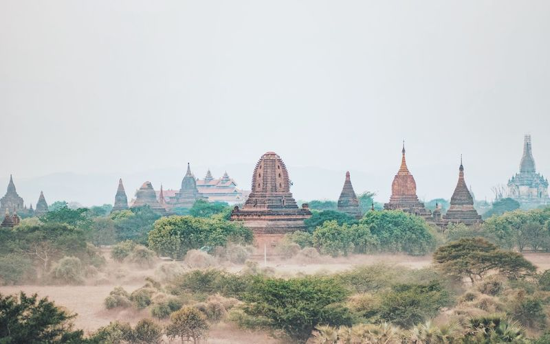 Temple on landscape against clear sky