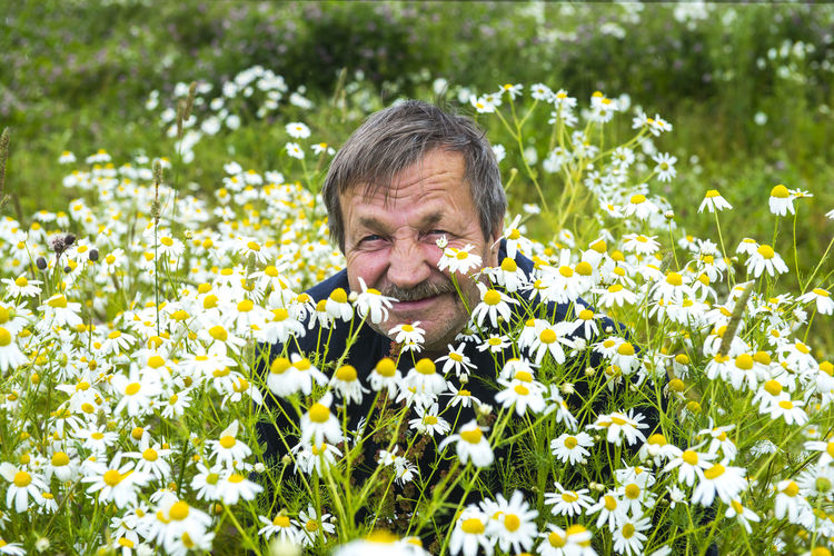 Beard Beauty In Nature Day Enjoyment Field Flower Flower Head Flowerbed Fragility Freshness Growth Happiness Nature Oilseed Rape One Man Only One Person Only Men Outdoors Plant Rural Scene Senior Adult Smiling Uncultivated Wildflower Yellow