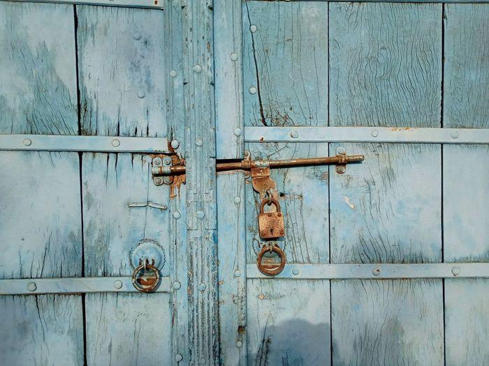 Full frame shot of weathered doors
