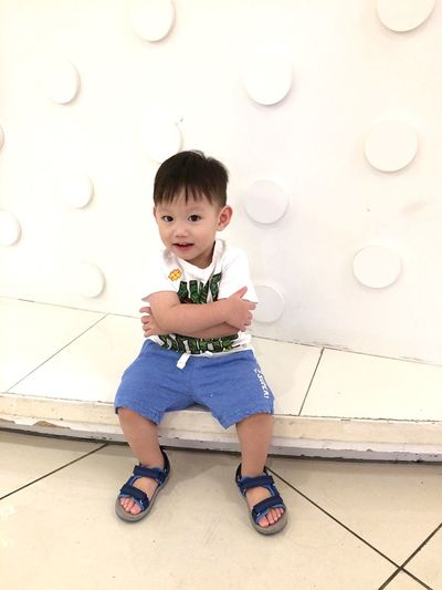 EyeEm Selects Full Length Childhood Child One Person Real People Cute Casual Clothing Front View Looking At Camera Lifestyles Males  Portrait Wall - Building Feature Boys Leisure Activity Innocence Flooring Tiled Floor