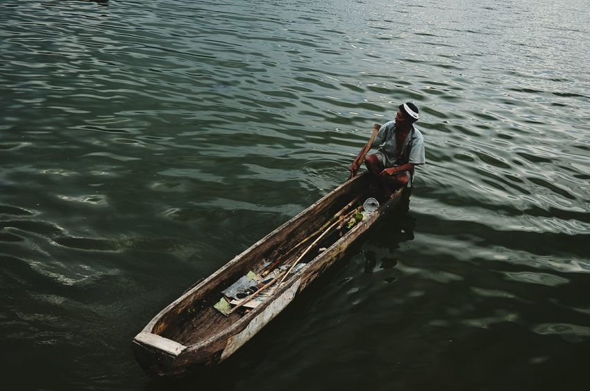EyeEm Selects Everyday Life Struggle For Existence Riverside Photography Canoe Lake Life Lake Nautical Vessel Water Mode Of Transport High Angle View Transportation Outdoors River Cultures Tradition Rowing Gondola - Traditional Boat Oar Gondolier