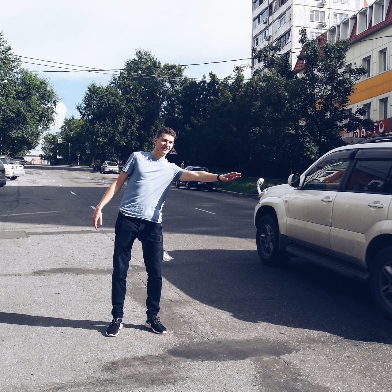 car, one person, tree, full length, transportation, real people, road, outdoors, day, men, young adult, people