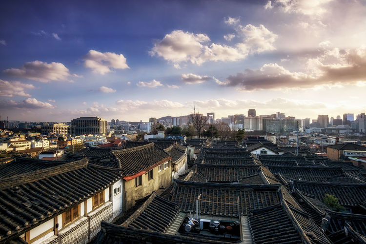 bukchon hanok village sunset view in south kroea Architecture Building Exterior Built Structure City City Life Cityscape Cloud Cloudy Community Composition Crowded Cultural Heritage Development Hanok Human Settlement Korea Outdoors Perspective Residential District Residential Structure Roof Seoul Sky Town TOWNSCAPE