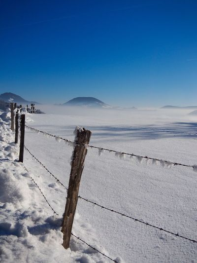 EyeEm Selects Nature Beauty In Nature Blue Scenics Tranquil Scene Winter Tranquility Cold Temperature Outdoors Day Mountain Landscape No People Snow Wooden Post Clear Sky Sky