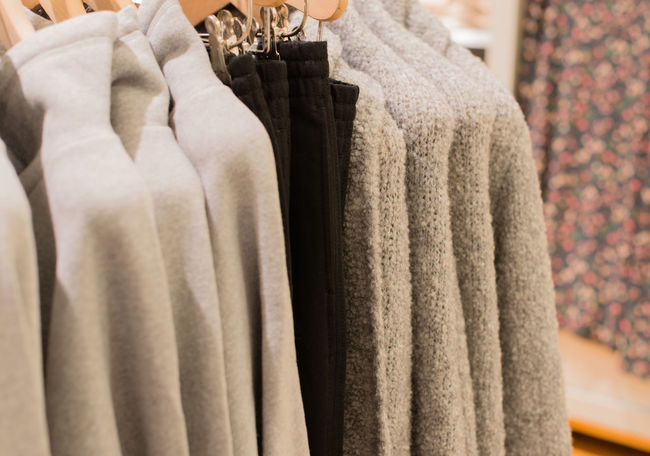 Cardigan on a clothes rack for winter closing Autumn Boutique Business Cardigan Clothes Stand Department Store Fashion Hanger Angora Jacket Angora Wool Clothes Clothing Clothing Cord Cord Sweater Knit Knitwear Ladies' Fashions Ladies' Sweaters Mohair Sweater Natural Fibres Retail Trade Sales Snugly Sweater