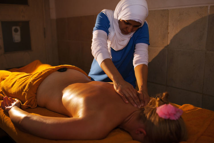 Woman receiving lastone therapy at spa