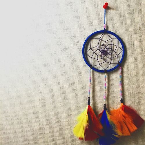 Dreamcatcher Hanging From Thumbtack On Bulletin Board