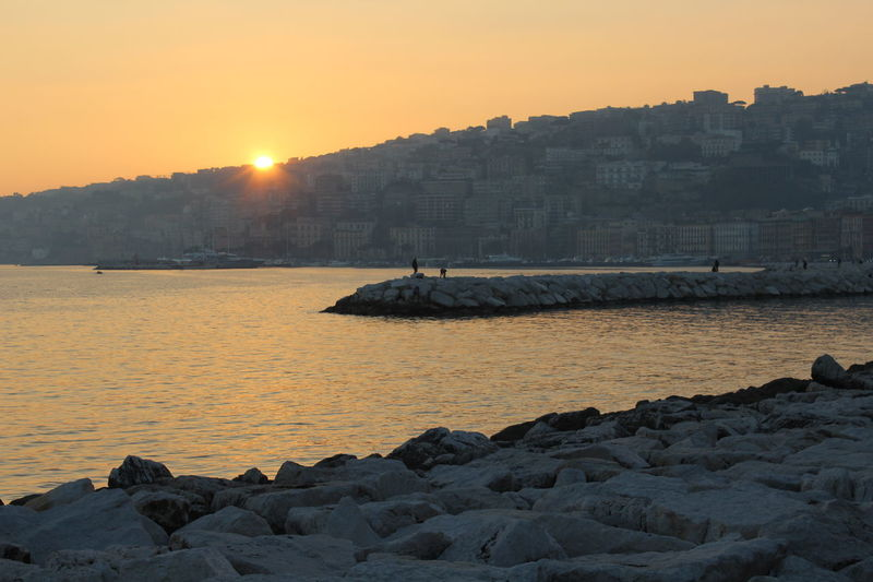 Mergellina, Naples Naples Paint The Town Yellow Beauty In Nature Clear Sky Coast Gooday Italy Nature Rock - Object Sea Sun Sunlight Sunset Tranquil Scene Tranquility Water Yellow