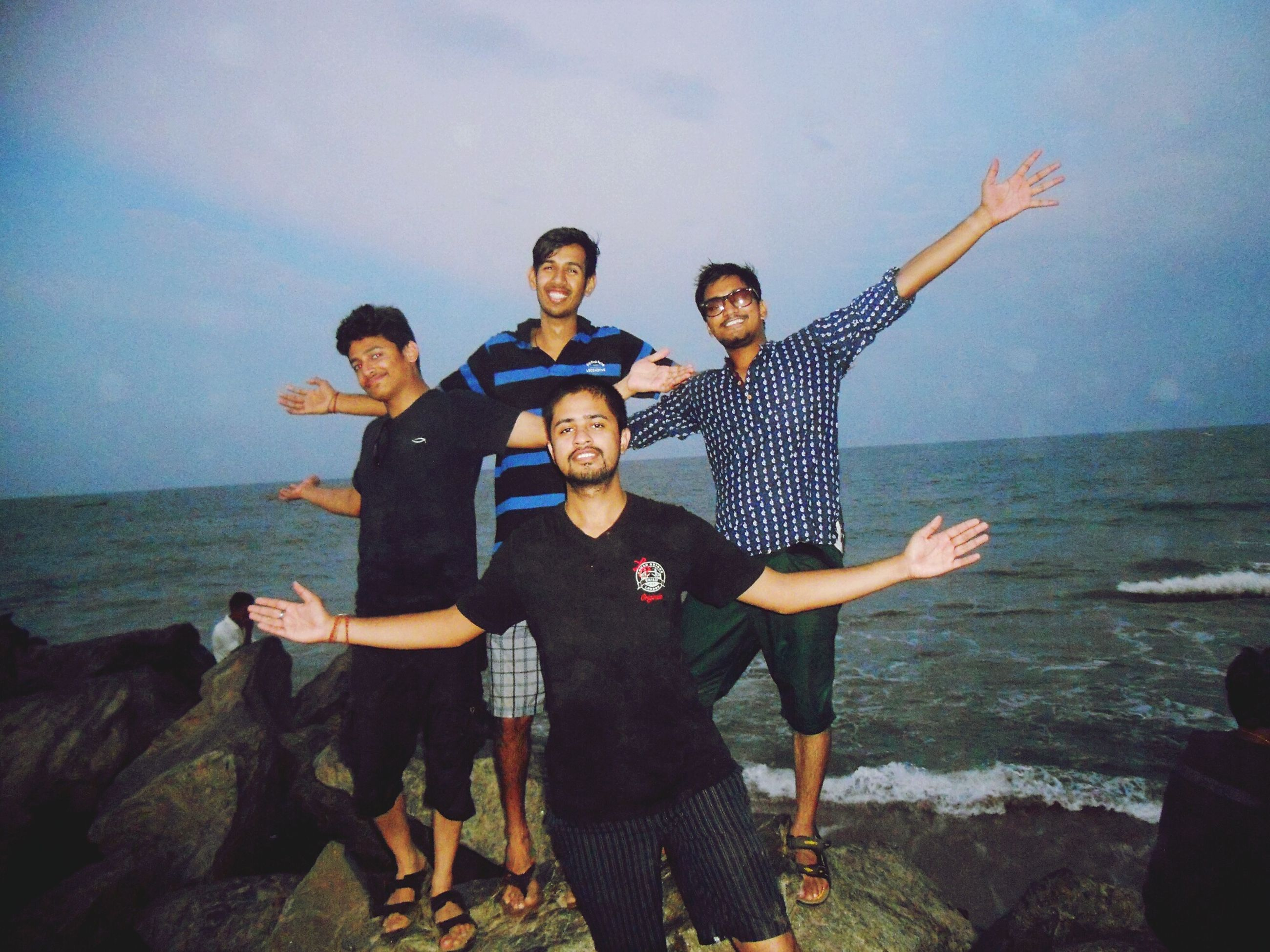 lifestyles, leisure activity, togetherness, young adult, water, young men, bonding, person, full length, sea, happiness, enjoyment, casual clothing, vacations, friendship, fun, love