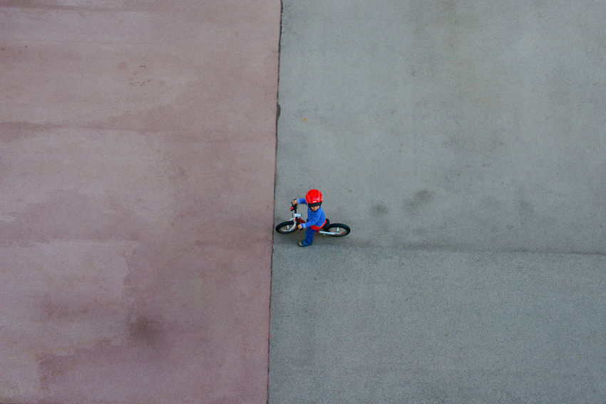 Bycicle Cycling Grey Sky High Angle View Kid Lines And Shapes Little Boy Purple Ground Red Helmet Split Image Weathered