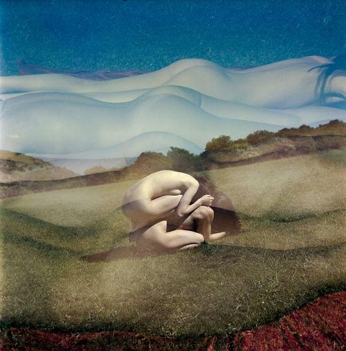 Digital composite image of woman hand on landscape