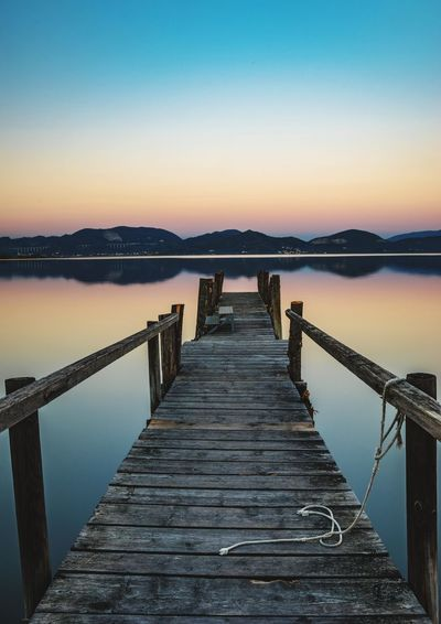Sunset Www.alexander-schitschka.de Sunset Nature Pier Water Lake Alps See Wasser Italy Toskana Toscana Reflection Tuscany Lake View Long Exposure Evening Landscape Clear Sky Travel Destinations Scenics Jetty Mountain The Week On EyeEm