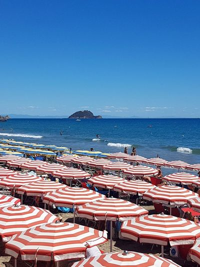 Business Finance And Industry Beach Sea Water Blue Outdoors Horizon Over Water No People Day Retail  Scenics Nature Clear Sky Sky Beauty In Nature Alassio Liguria Liguria, Italy Summer