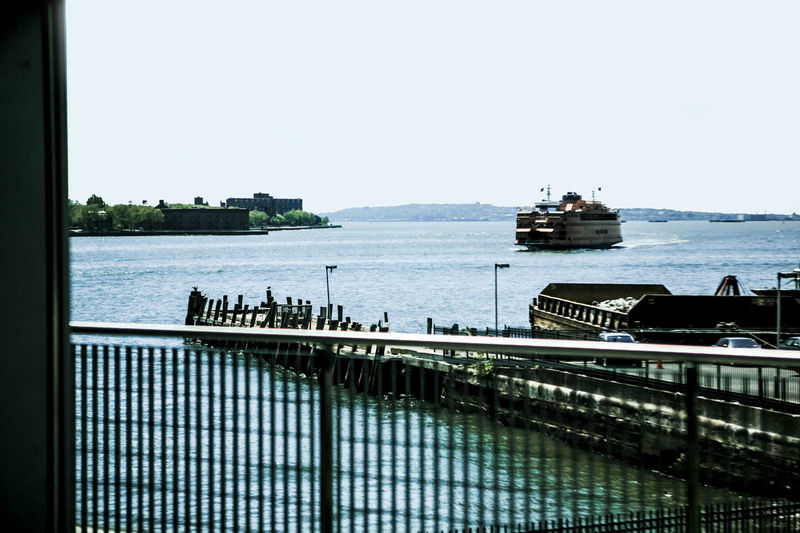 Boat Bridge Built Structure Connection Development Distant Engineering Fence Hudson River Island Jetty Modern Nautical Vessel Ocean Outdoors Pier Railing Railings Rippled River Riverside Sea Ship Water Waterfront