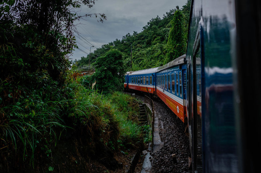 On board of the Reunification Express. Railroad Track Travel Vietnam Day Green Color Growth Journey Jungle Land Vehicle Mode Of Transportation Motion Mountain Nature No People Outdoors Passenger Train Plant Public Transportation Rail Transportation Railroad Track Sky Train Train - Vehicle Transportation Travel