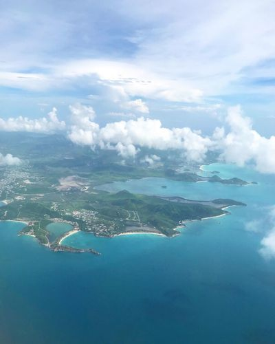 Cloud - Sky Water Sky Scenics - Nature Beauty In Nature Sea Tranquility Day Tranquil Scene Nature No People Aerial View Blue Outdoors Idyllic Land Beach Island Travel Destinations Turquoise Colored