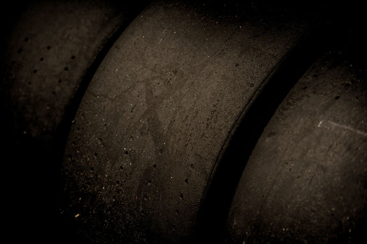 Set of racing car motorsport tires detail Motorsport Set Tires Black Close-up Detail Indoors  No People Racing Tires Racing Wheel Slick Tires
