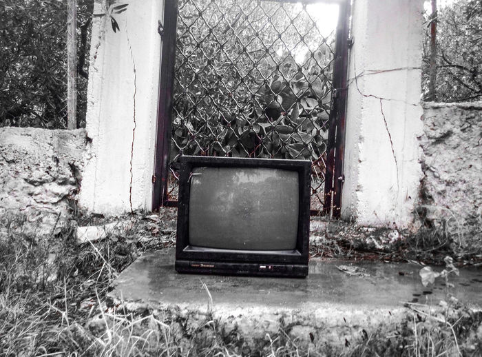 Abandoned Technology Absence Black & White Close-up Day Deterioration Empty Front Or Back Yard Futurepast Grass Green Color Growth Nature No People Old Outdoors Past And Present Stationary Television Tranquility