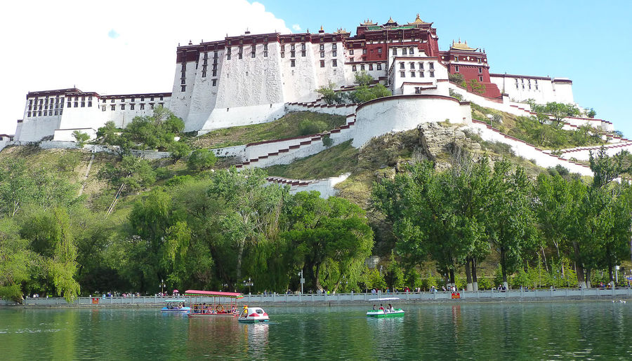 In the park behind the Potala Palace in Lhasa: small boats on the lake Tibet Lhasa, Tibet Potala Palace Potala Palace, Tibet, China Potala Palace And Surroundings Lake Boats Boats⛵️ Water Architecture Building Exterior Travel Destinations Outdoors