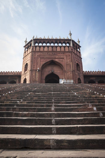 step of stairway to inside of Jama Misjid from gate number 3 Islam Mosque Arch Architecture Built Structure Cloud - Sky Day Delhi, India India Travel Indiapictures JamaMasjid Landmark Low Angle View Muslim Outdoors Stairs Steps Travel Destinations