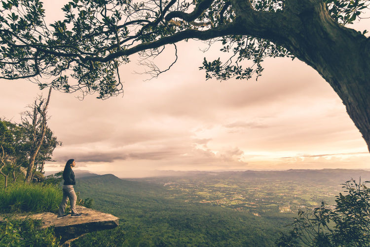 Beside Cliff Cloud - Sky Hiking Landscape Leisure Activity Lifestyles Nature One Person Outdoors Real People Sky Standing Standing Sunset Sunset_collection Tree Women Lost In The Landscape