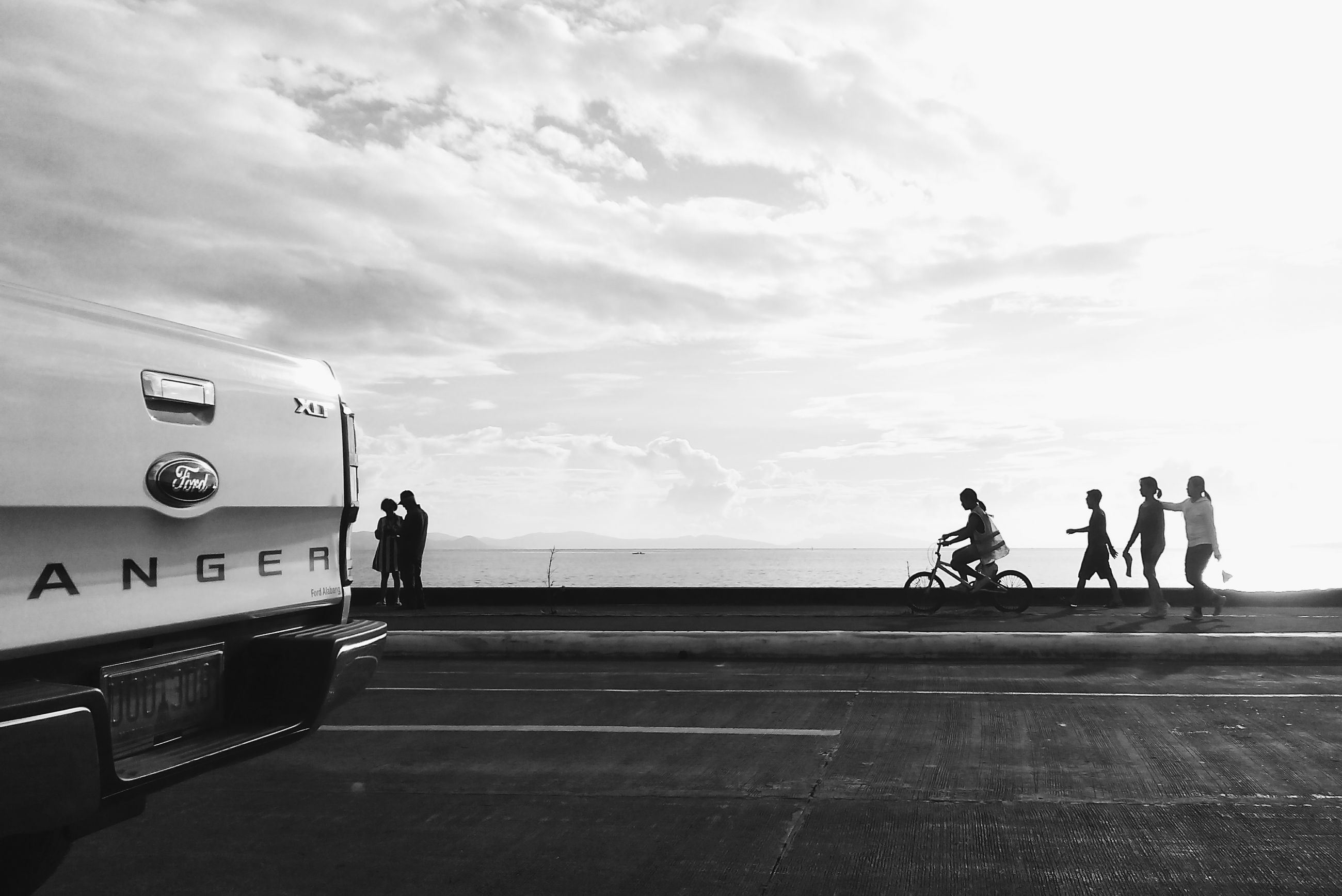 transportation, road, sky, group of people, cloud, city, city life, sea, day, outdoors, journey, cloud - sky, ocean, tourism