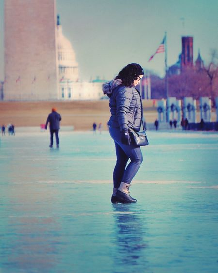 US Capitol Building Washington Monument Reflecting Pool Walking On Ice Frozen Icy Water Icy Real People Full Length Leisure Activity Lifestyles One Person Architecture Built Structure Young Women Outdoors Building Exterior Young Adult Day Sky People
