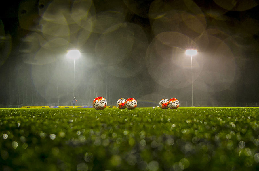 Field Grass Green Color Growth Illuminated Lens Flare Nature Night No People Outdoors Playing Field Selective Focus Soccer Field
