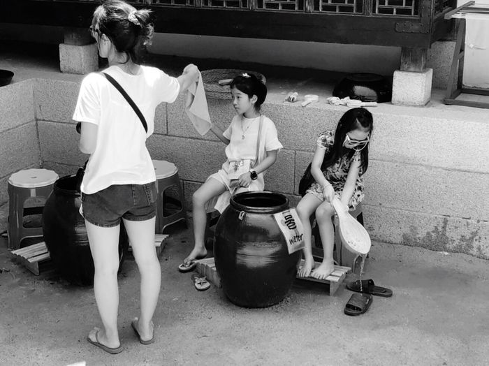 Outdoor photography series: Wash your foots before you go into the room Hot Day Outside Korean Customs Outdoor Photography Seoul, Korea My Asia Trip 2018 Full Length Women Sitting Group Of People Real People Child Girls Casual Clothing Leisure Activity Adult Females Lifestyles Togetherness Childhood Seat Rear View People Day Sister