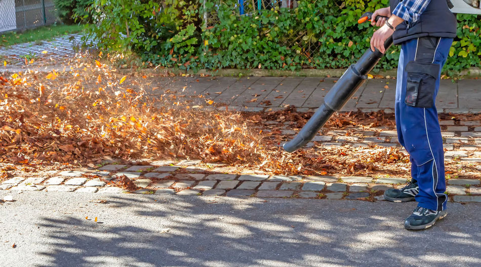 Man working with leafblower Leafblower Fall Autumn Working Cleaning Leafes Nature Streetphotography Baden-Württemberg  Germany Worker City Street Neighborhood Leaf Blower Environment Loud Ecology Noise Holding Disturbance Season  Oktoberfest November