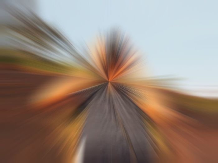 Close-up of blurred motion of car against sky