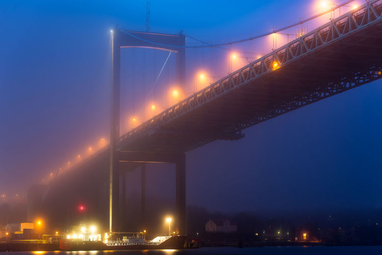 A cold and foggy night in Gothenburg, Sweden Blue Sky Bridge Bridge In Fog Canon6d Fog Foggy Bridge Foggy City Goteborg Gothenburg Gothenburgbynight HDR Long Exposure Multiple Exposures Night Shot Nightphotography Nightshot Sigma70-300 Swedish Yellow Lights älvsborgsbron