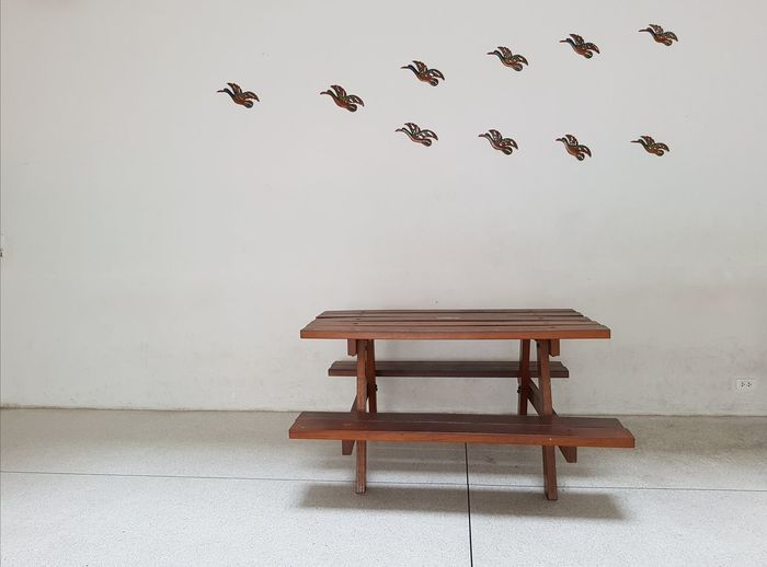 Freedom and feel silent. Free Table Nobody Around Silent Moment Bird Flying Furniture Beach Sky Flock Of Birds Large Group Of Animals Spread Wings