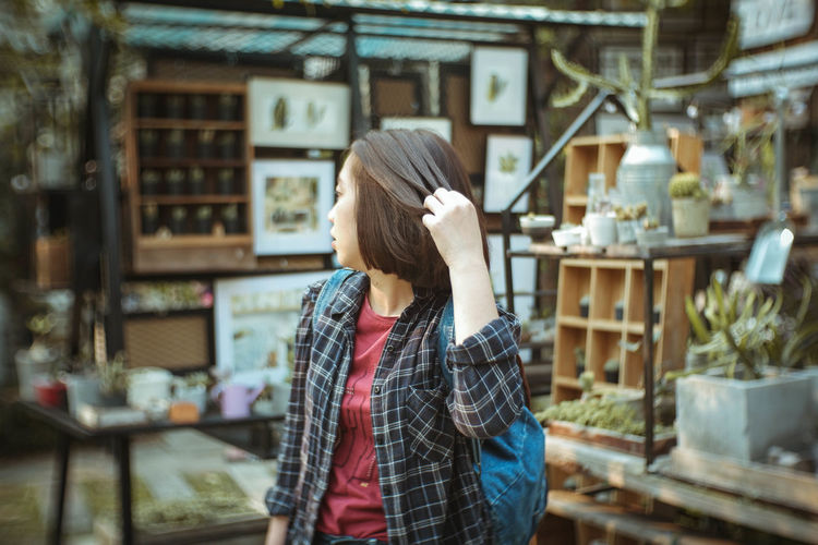 Parting is such sweet sorrow. One Person Real People Hair Adult Hairstyle Casual Clothing Women Waist Up Focus On Foreground Lifestyles Long Hair Standing Indoors  Rear View Young Adult Day Leisure Activity Architecture Young Women Human Face