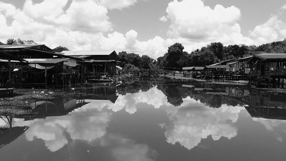 Sarawak Malaysia River Houses Black And White River House Malaysia Truly Asia House Village Nature Architecture Reflection Cloud - Sky Reflection Water Sky Outdoors Architecture Day Building Exterior No People Nature