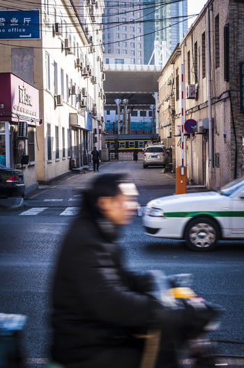 Blurred motion of man on street in city