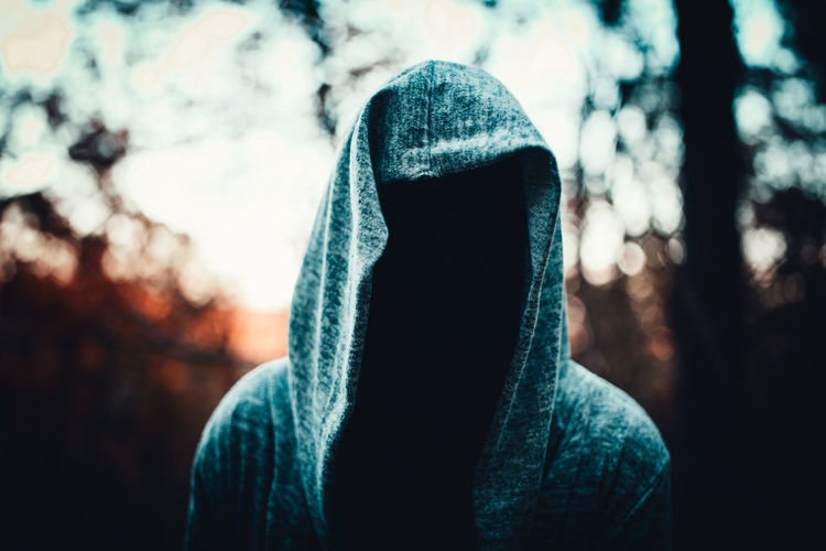 Close-up of invisible man wearing hooded shirt