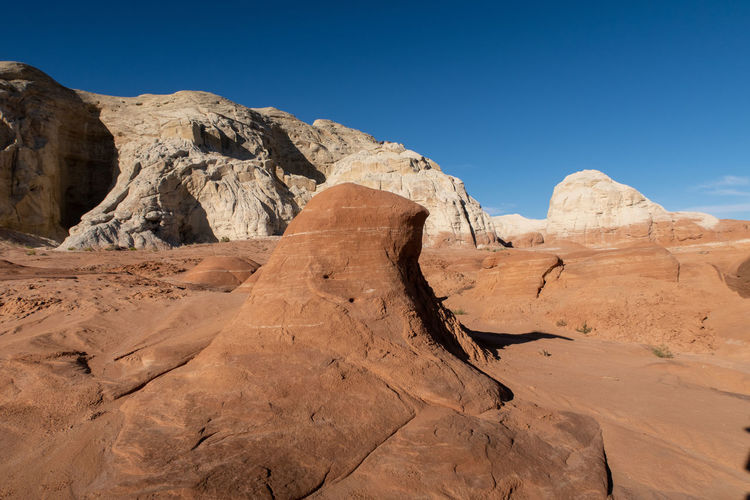 Landscape of brown and white stone formations at the toadstools in grand staircase escalante in utah